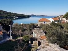 Dom na ostrove Kaprije